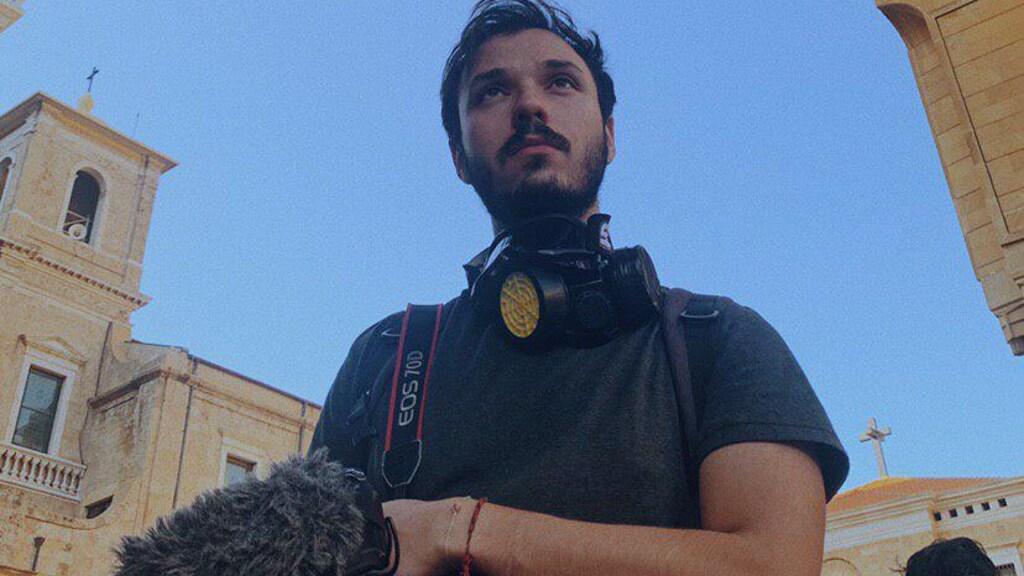 Cameraman Firas aan het werk.