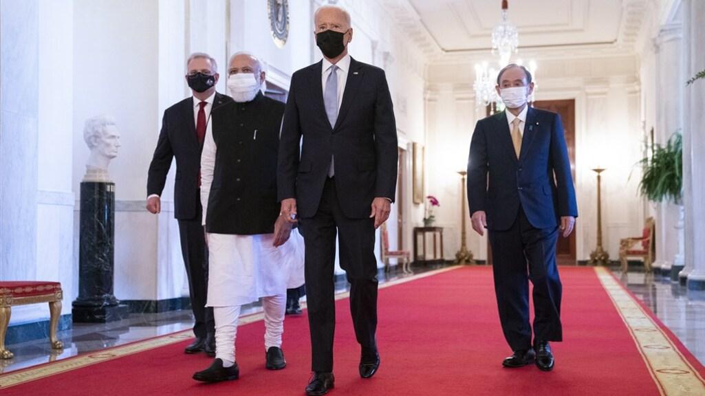 Scott Morrison (Australië), Narendra Modi (India), Joe Biden (VS) en Yoshihide Suga (Japan) voorafgaand aan hun Quad-bijeenkomst.