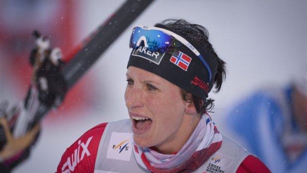Björgen prolongeert olympische titel