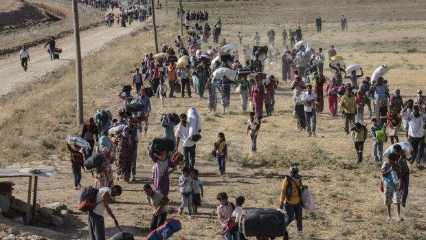 Tienduizenden Koerden in één dag naar Turkije gevlucht