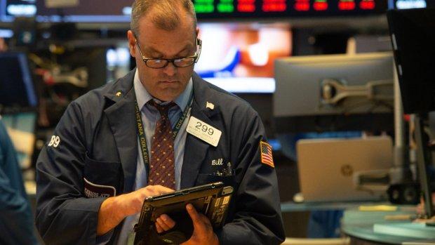 Wall Street sluit maar licht lager; Fed verhoogt rente mogelijk minder snel