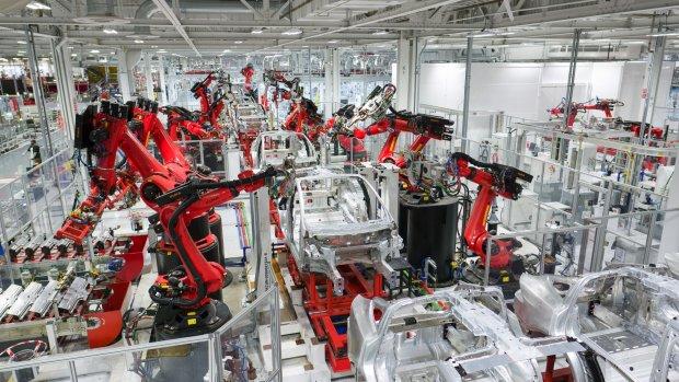 Hoe een Tesla Model 3 wordt gemaakt in één minuut
