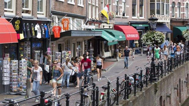 Nederlanders kregen meer te besteden, maar bleven zuinig