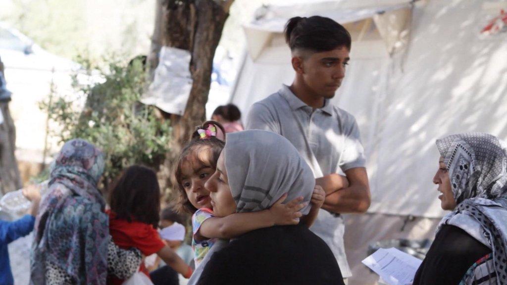 Migranten in het kamp Moria.