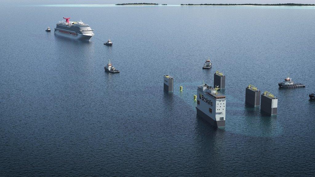 De Carnival Vista wordt met sleepboten op de BOKA Vanguard getrokken.