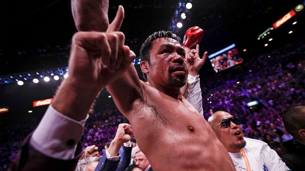 Pacquiao na zijn overwinning.