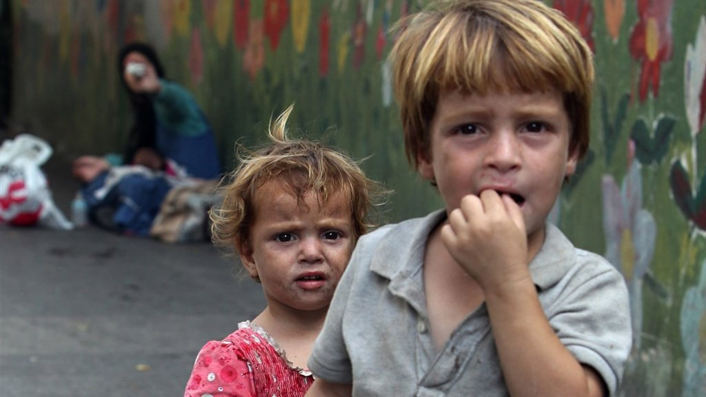 Syrische vluchtelingenkinderen bedelen om geld in de Libanese hoofdstad Beiroet.