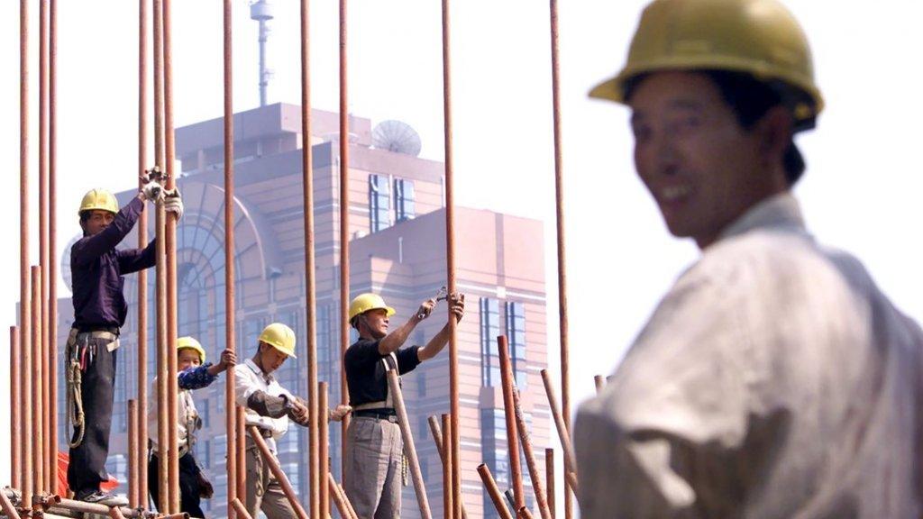 Arbeiders aan het werk in Peking (2000).