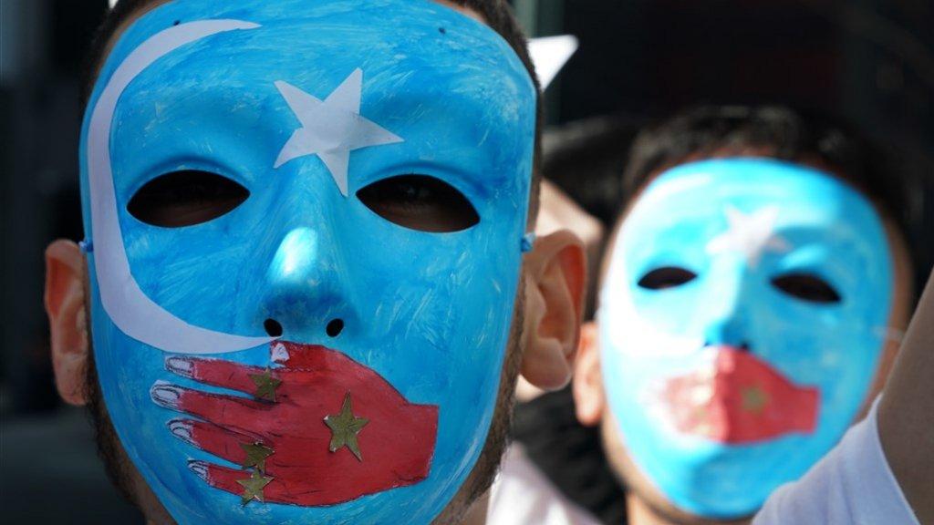 Een protest tegen de onderdrukking van Oeigoeren in China.