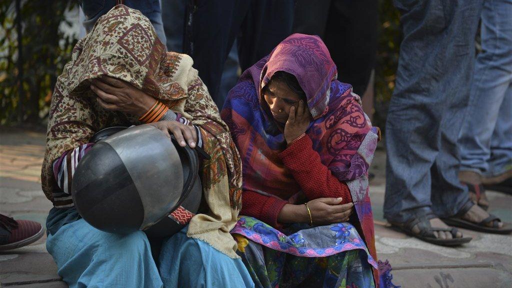 Vrouwen treuren om slachtoffers