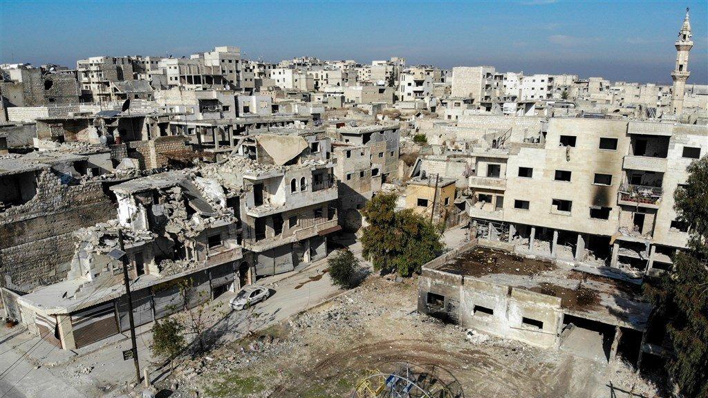 Zwaar gehavende gebouwen in Maaret al-Numan.