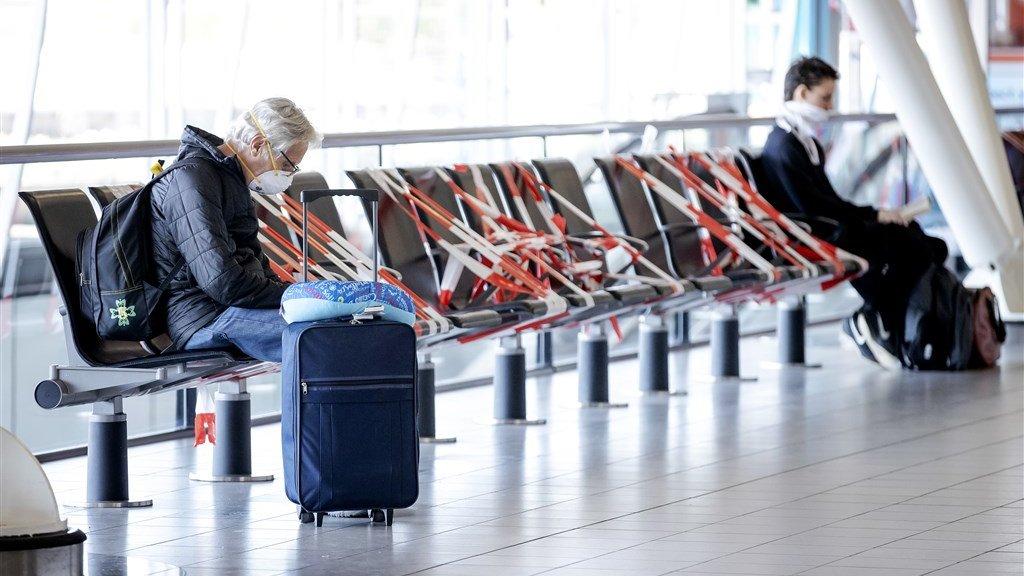 Reizigers op Schiphol.