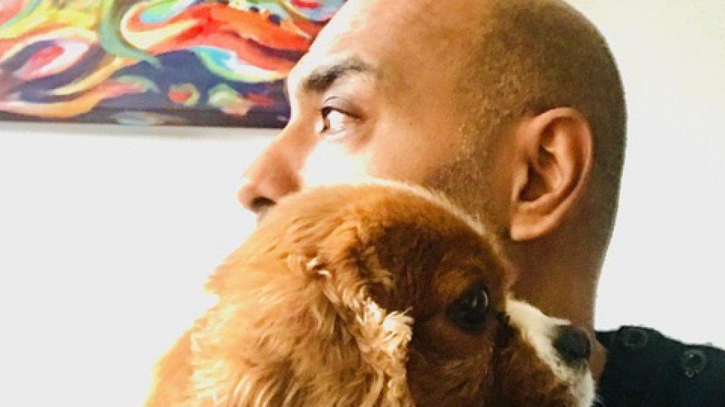 Nassiri en zijn hondje Boy.